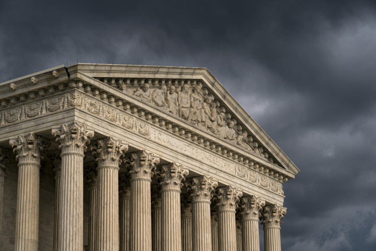 FILE - In this June 20, 2019, file photo, the Supreme Court is seen in Washington as a storm rolls in. On one side of an upcoming Supreme Court case over a proposed natural gas pipeline in New Jersey are two lawyers with more than 250 arguments between them. On the other is Jeremy Feigenbaum, a lawyer for New Jersey who will be making his first Supreme Court appearance.(AP Photo/J.