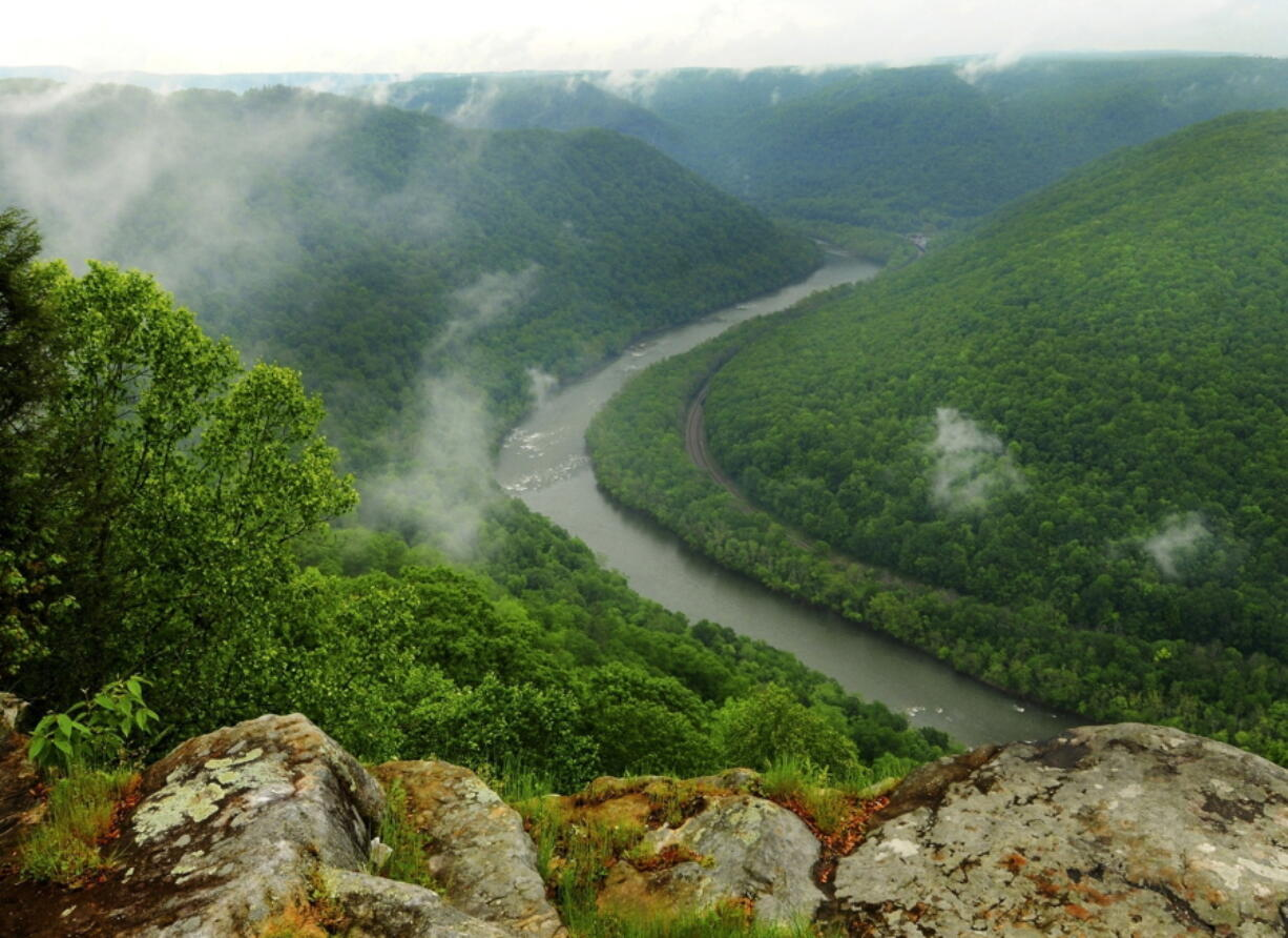FILE - This May 9, 2012, file photo, shows the Grandview State Park overlooking the New River Gorge National River in Grandview, W.Va. The state offers numerous trails for hiking and other spots with scenic views. With West Virginia poised to lose another congressional seat due to its long, steady population decline, Republican lawmakers are convinced a massive tax cut is the key to reversing the trend.