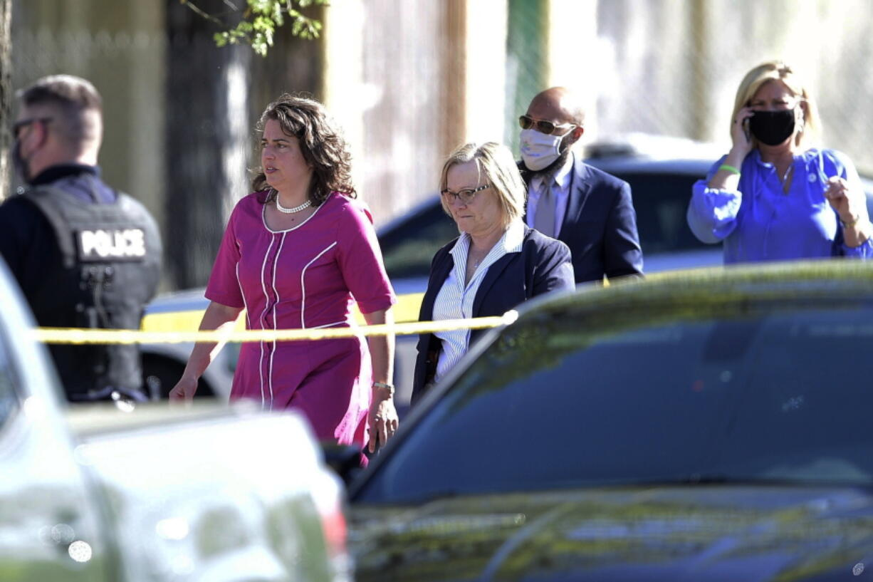 Knoxville Mayor Indya Kincannon, left, arrives at the scene of a shooting at Austin-East High School in Knoxville, Tenn. on Monday, April 12, 2021.