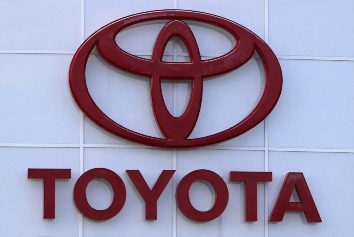 This Aug. 15, 2019 file photo shows the Toyota logo on a dealership in Manchester, N.H. Toyota is recalling nearly 280,000 Venza SUVs in the U.S., Thursday, April 15, 2021,  because a wiring problem could stop the side air bags from inflating in a crash. The recall covers Venzas from the 2009 through 2015 model years.