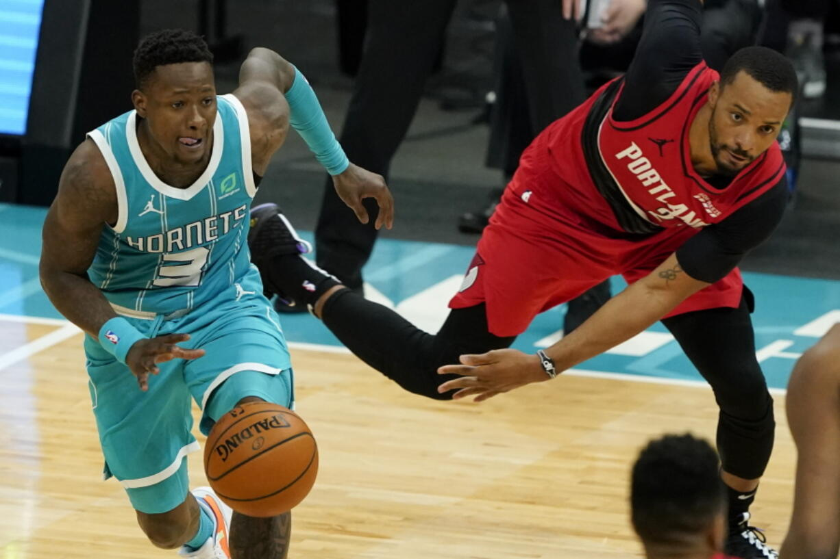 Charlotte Hornets guard Terry Rozier drives past Portland Trail Blazers forward Norman Powell during the second half in an NBA basketball game on Sunday, April 18, 2021, in Charlotte, N.C.