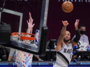 Portland Trail Blazers guard Damian Lillard (0) shoots a three-point goal during the second half of an NBA basketball game against the Brooklyn Nets, Friday, April 30, 2021, in New York.