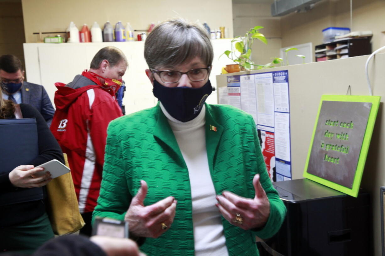 Kansas Gov. Laura Kelly answers questions from reporters following a tour of a childcare center, Wednesday, March 17, 2021, in Topeka, Kan.