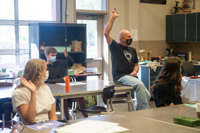 """Rod Raunig, center, teaches a class called """"Everything in Art"""" at Camas High School on Monday, April 19, 2021. Camas returned to four-day-a-week in-person instruction on Monday."""