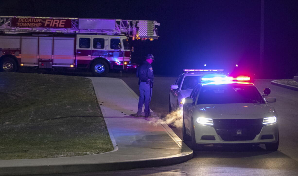 Police and fire teams arrive at the scene outside a FedEx facility in Indianapolis where multiple people were reportedly shot at the FedEx Ground facility early Friday, April 16, 2021, in Indianapolis, Indiana. Multiple people were shot and killed in a late-night shooting at a FedEx facility in Indianapolis, and the shooter killed himself, police said.