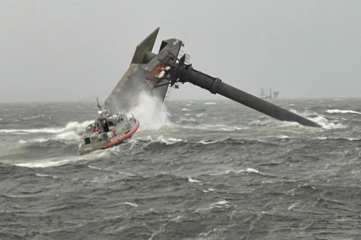 A Coast Guard Station Grand Isle 45-foot Respone Boat-Medium boatcrew heads toward a capsized 175-foot commercial lift boat Tuesday, April 13, 2021, searching for people in the water 8 miles south of Grand Isle, Louisiana. The Coast Guard and multiple other boats rescued six people onboard a commercial lift boat that capsized off the coast of Louisiana on Tuesday night and were searching for more, the agency said.(U.S.