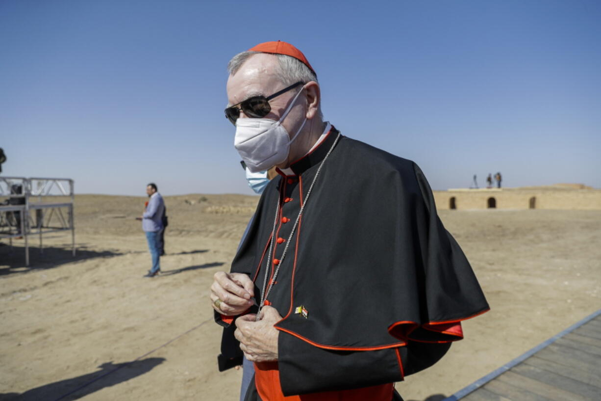 """FILE - In this file photo taken on March 6, 2021, Vatican Secretary of State Cardinal Pietro Parolin arrives ahead of an interreligious meeting with Pope Francis near the archaeological area of the Sumerian city-state of Ur, 20 kilometers south-west of Nasiriyah, Iraq. The Vatican No. 2 is skipping a planned trip to Venezuela this week because of the coronavirus pandemic. Cardinal Pietro Parolin, the Vatican's former ambassador to Caracas, had planned to celebrate the April 30 beatification of Jose Gregorio Hernandez, dubbed the """"doctor of the poor."""" The Vatican said Wednesday that due to issues linked to the pandemic, Parolin wouldn't make the trip."""