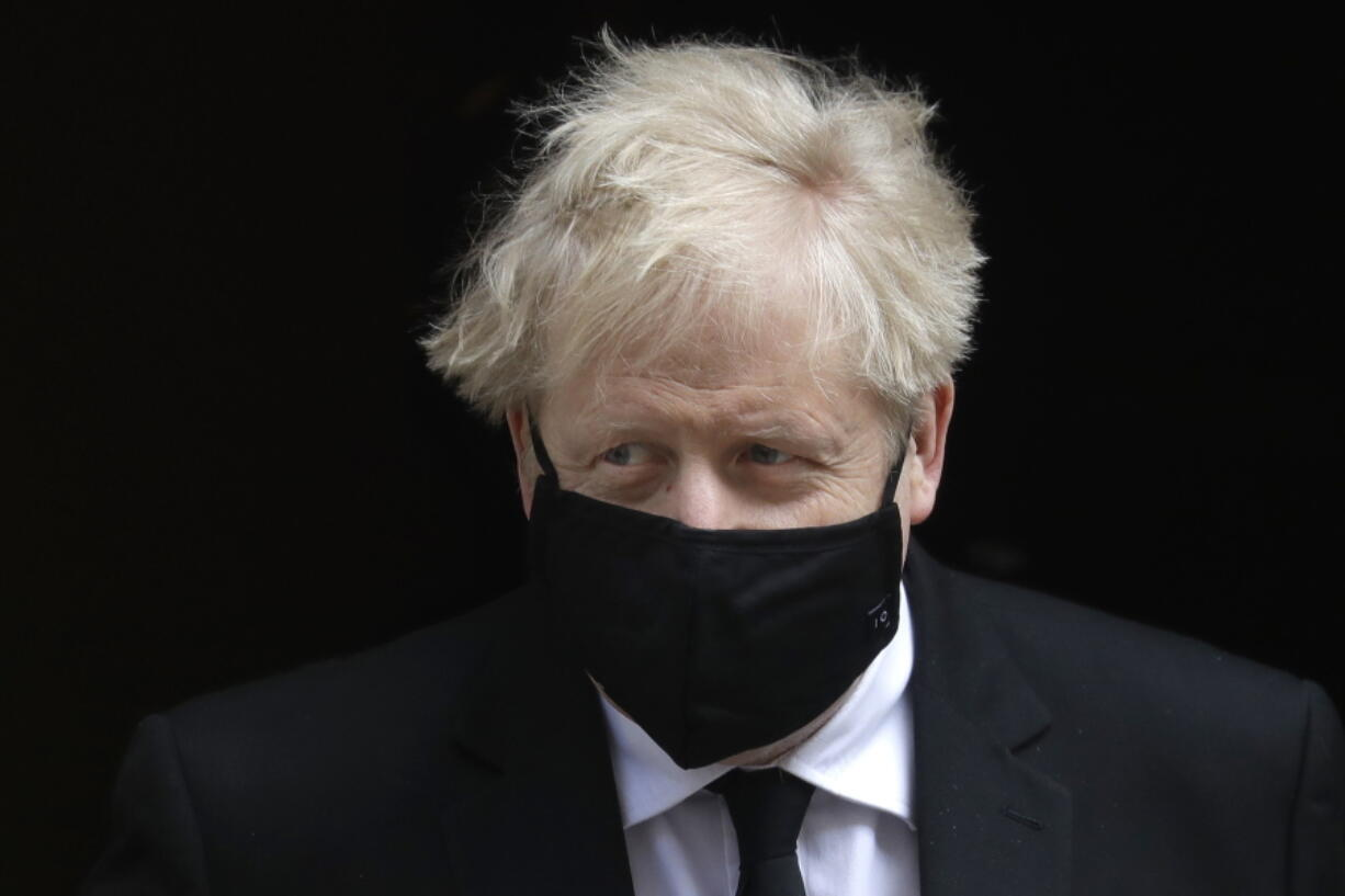 Britain's Prime Minister Boris Johnson leaves 10 Downing Street to attend the weekly session of Prime Ministers Questions in Parliament in London, Wednesday, April 14, 2021.