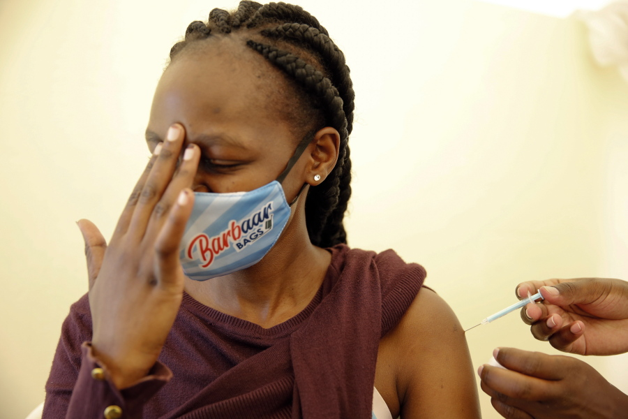 FILE - In this April 8, 2021, file photo, a woman at Kenyatta National Hospital in Nairobi, Kenya, receives a dose of AstraZeneca COVID-19 vaccine manufactured by the Serum Institute of India and provided through the global COVAX initiative. COVAX is providing vaccines to countries lacking the clout to negotiate on their own for scarce supplies, but in the past two weeks only 2 million doses have been cleared for shipment to 92 countries.