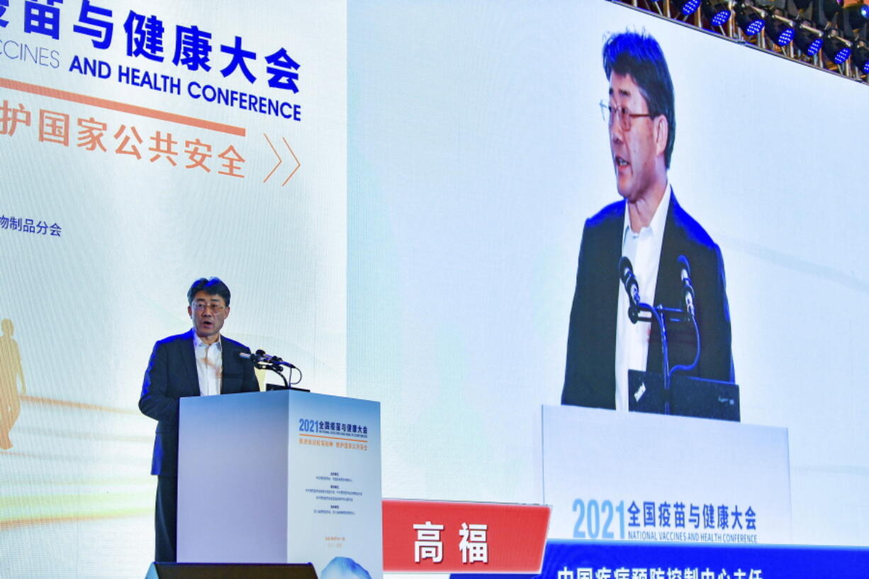 Gao Fu, director of the China Centers for Disease Control, speaks at the National Vaccines and Health conference in Chengdu in southwest China's Sichuan province Saturday, April 10, 2021. In a rare admission of the weakness of Chinese coronavirus vaccines, Gao the country's top disease control official says their effectiveness is low and the government is considering mixing them to give them a boost.