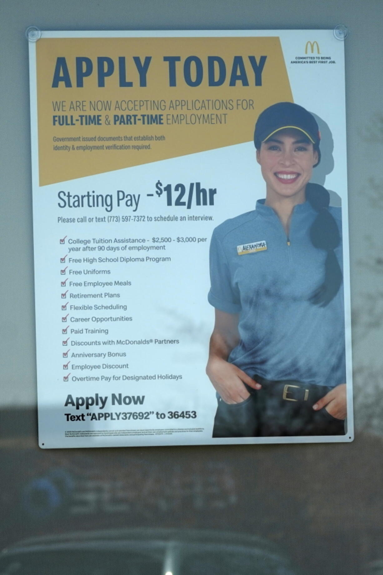 A hiring information sign is displayed at a fast food restaurant in Des Plaines, Ill., Friday, April 2, 2021. America's employers unleashed a burst of hiring in March, adding 916,000 jobs in a sign that a sustained recovery from the pandemic recession is taking hold as vaccinations accelerate, stimulus checks flow through the economy and businesses increasingly reopen. (AP Photo/Nam Y. Huh) (nam y.