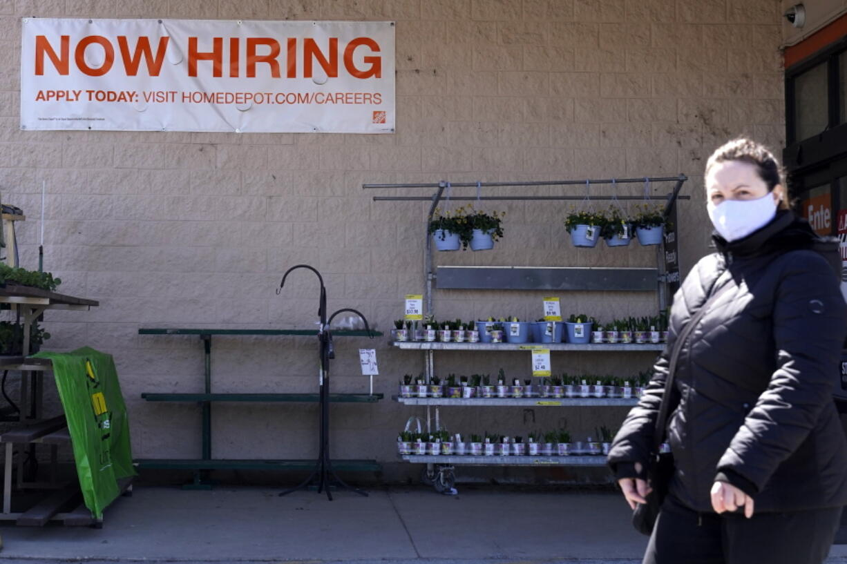 A hiring sign is seen outside home improvement store in Mount Prospect, Ill., Friday, April 2, 2021.  The pace of job openings reached the highest level on record in February, a harbinger of healthy hiring and a hopeful sign for those looking for work.  (AP Photo/Nam Y.
