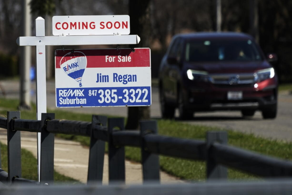 """A """"for sale"""" sign stands along side a housing lot in Mount Prospect, Ill., Friday, April 2, 2021. U.S. home prices increased at the fastest pace in seven years in January as the pandemic has fueled demand for single-family houses even as the supply for such homes shrinks. (AP Photo/Nam Y."""