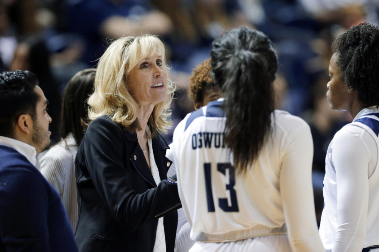 FILE - In this Nov. 17, 2019, file photo, Rice head coach Tina Langley talks with her players during a timeout in the second half of an NCAA college basketball game against Texas A&M in Houston. Washington hired Langley as its new women's basketball coach Monday, April 5, 2021, giving one of the top coaches in Conference USA over the past six seasons her first shot at leading a Power Five program.