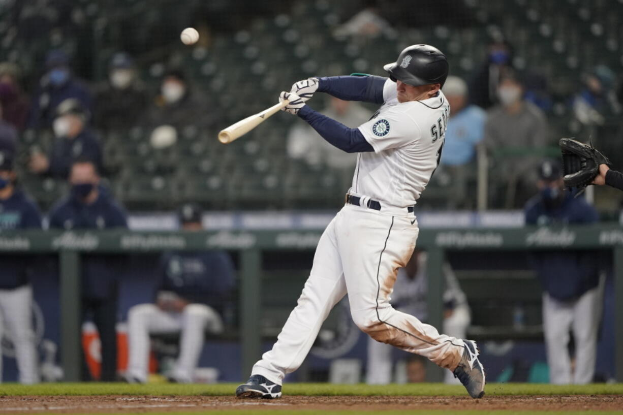 Seattle Mariners' Kyle Seager hits a three-run double during the sixth inning of the team's baseball game against the Chicago White Sox, Wednesday, April 7, 2021, in Seattle. (AP Photo/Ted S.