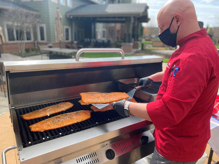Patrick grilling out at The Quarry Senior Living