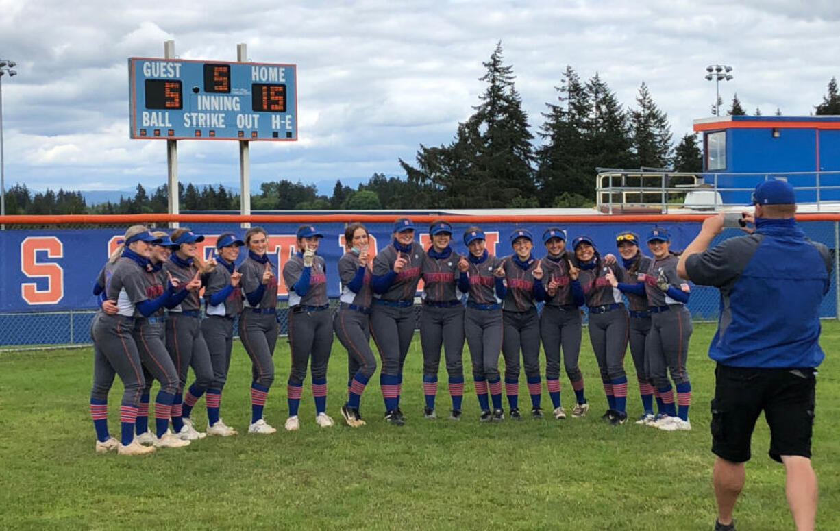 The Ridgefield softball team poses for a photo after beating Columbia River 15-5 on Saturday at Ridgefield High. The win clinched the 2A Greater St. Helens League title for the Spudders.