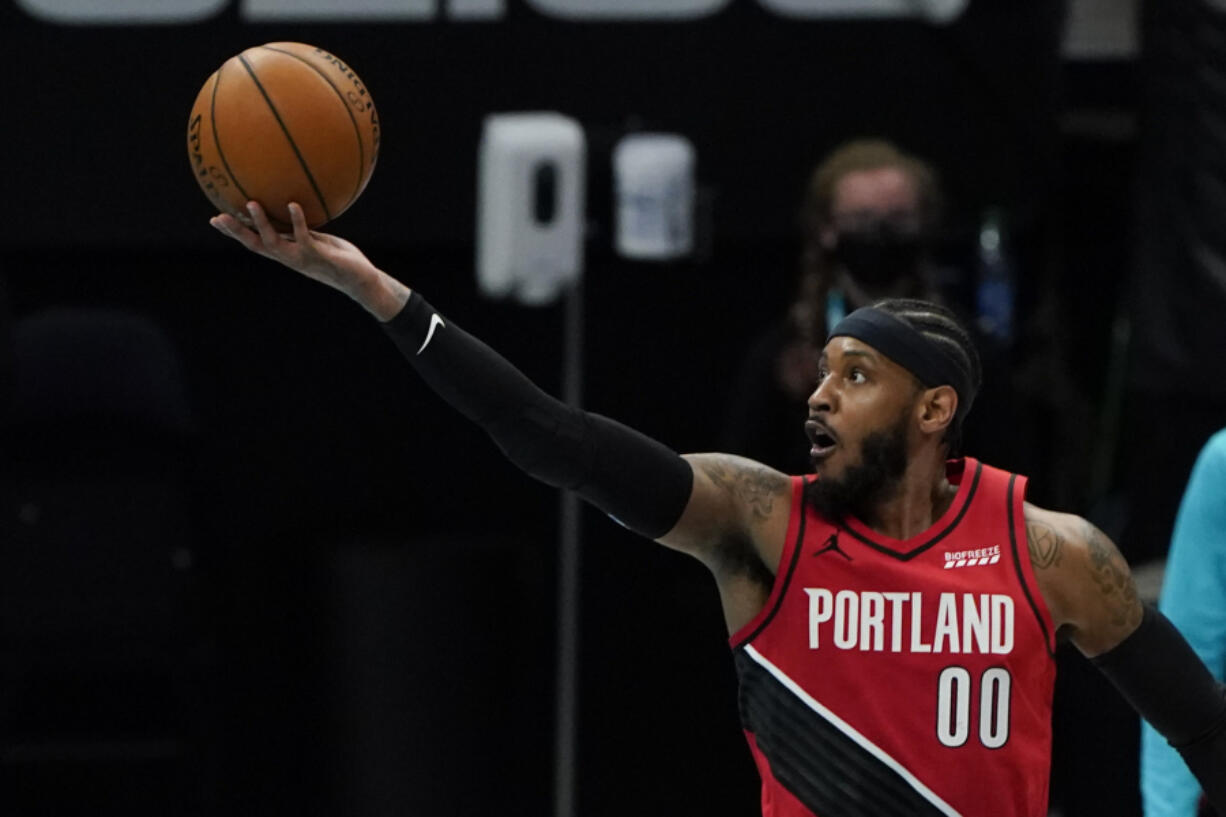 Portland Trail Blazers forward Carmelo Anthony shoots against the Charlotte Hornets during the first half in an NBA basketball game on Sunday, April 18, 2021, in Charlotte, N.C.