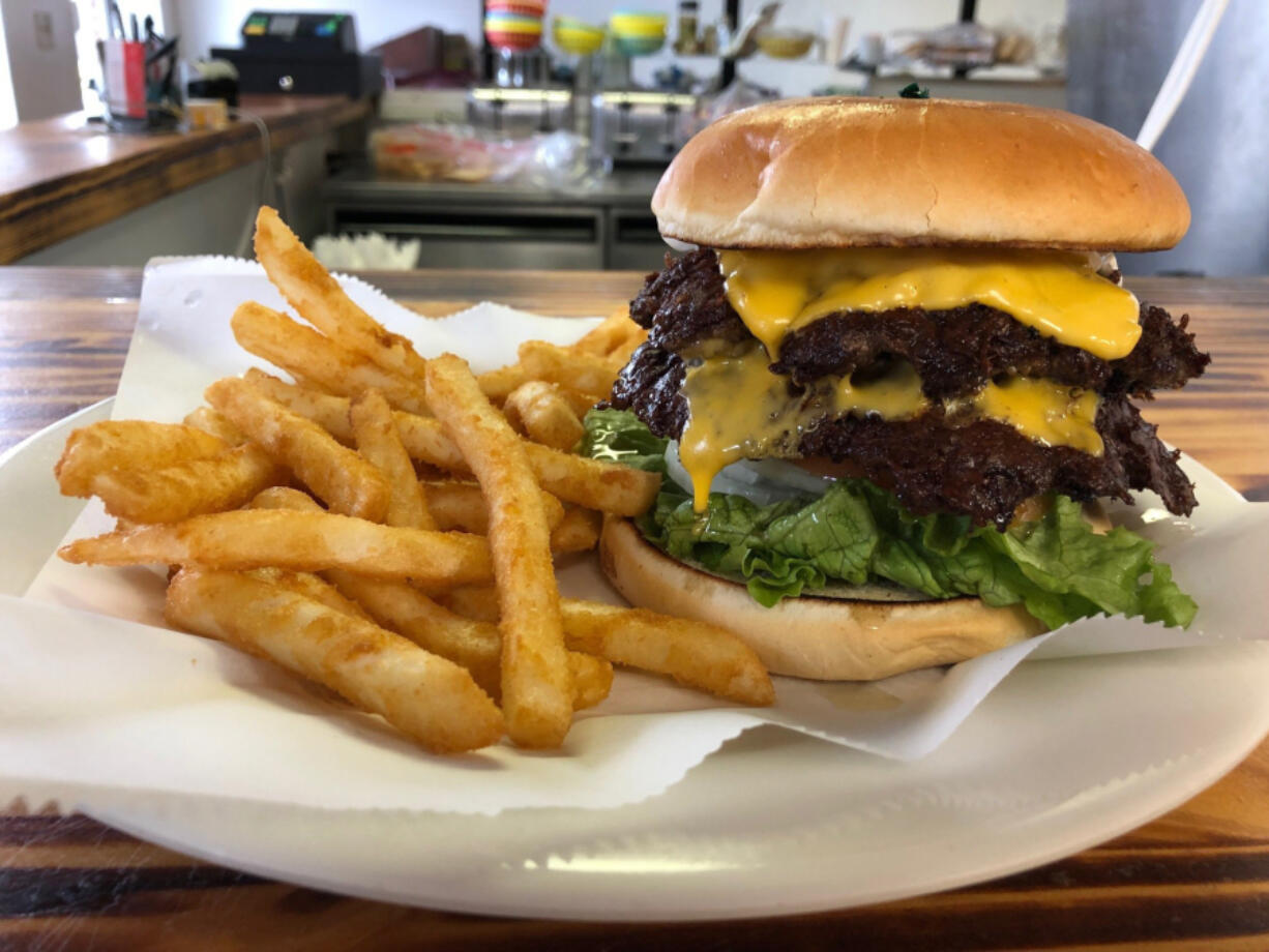 At the Florissant City Diner, the double cheeseburger and fries are a popular order.(Daniel Neman/St.