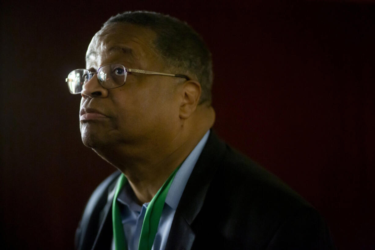 Larry Gossett, a former King County Council member, says his father was told he could not buy a house in West Seattle because of his race. Gossett is shown during his election night gathering at Emerald Community Church in Seattle.