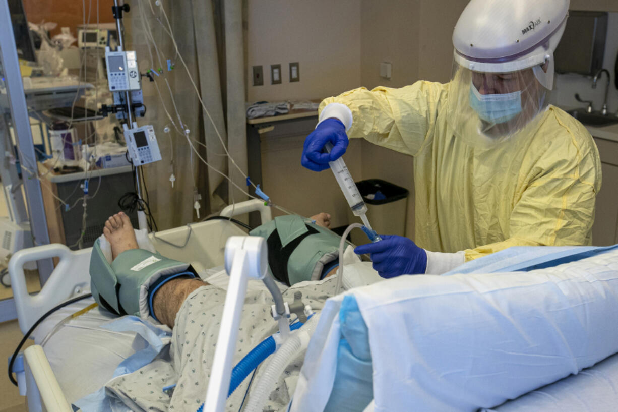 A patient is treated at Arrowhead Regional Medical Center on Dec. 23, 2020, in Colton, California.