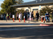 People wait in line to vote at  Dan Ruiz Branch Library on November 3, 2020, in Austin, Texas.