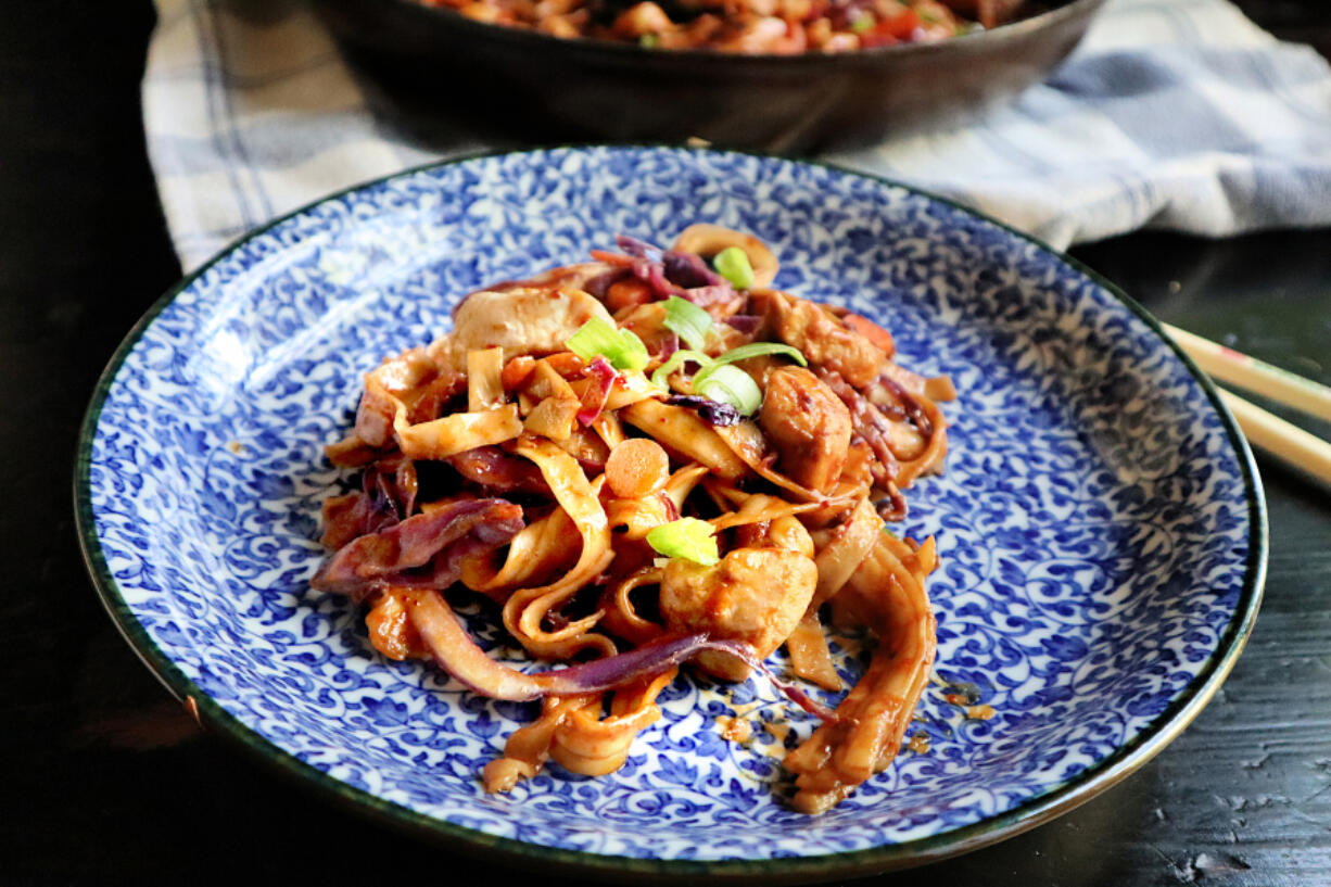 Lo mein noodles tossed in a spicy peanut sauce get an extra boost from tender chunks of chicken.