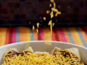 For Beef Enchiladas, cheese is applied before the final baking. (Hillary Levin/St.