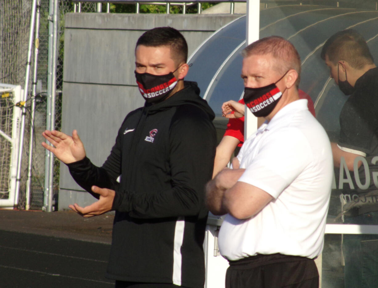 Camas interim boys soccer co-coaches Josh Stoller, left, and Richard Gooch watch the Papermakers play against Mountain View on Monday, May 10, 2021.