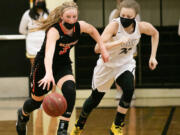 Washougal's Savea Mansfield (3) dribbles down the court while being defended by Hudson's Bay's Paytin Ballard (21) during the third quarter of a girl's high school basketball game at Hudson's Bay High School on Wednesday.