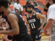 Union's Izaiah Vongnath (center) joins teammates in the second quarter against Battle Ground at Battle Ground High School on Tuesday night, May 11, 2021.
