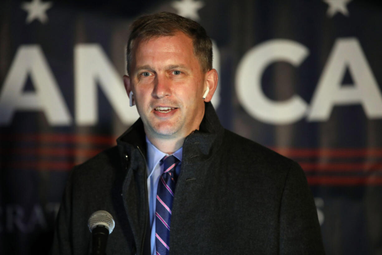 U.S. Rep. Sean Casten talks with supporters and reporters at his election night watch party at the Chicago Drive-In Theater in Hoffman Estates on Nov. 3, 2020.