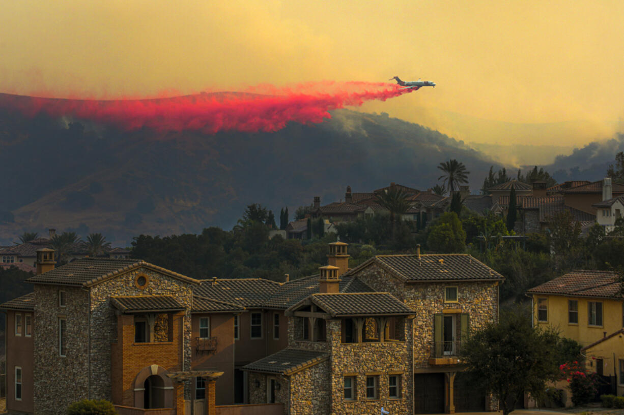 An air tanker drops fire retardant during a wildfire in 2020 in Chino Hills, California.