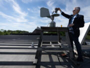 Allergist Donald Dvorin collects a pollen sample from a trap on the roof above his practice in Mount Laurel, Pa. It's the first step in a labor-intensive process that evidently isn't appealing to many colleagues these days.