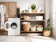 One way to make a laundry room feel welcoming is to incorporate cabinetry and shelving to stay organized.