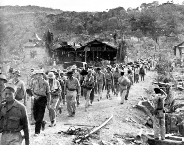 In this 1942 photo, American and Filipino prisoners of war captured by the Japanese are shown at the start of the Death March after the surrender of Bataan on April 9 near Mariveles in the Philippines.