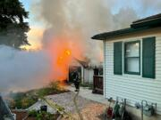 A detached garage behind a house at 2715 P Street in Vancouver went up in flames on Sunday morning.