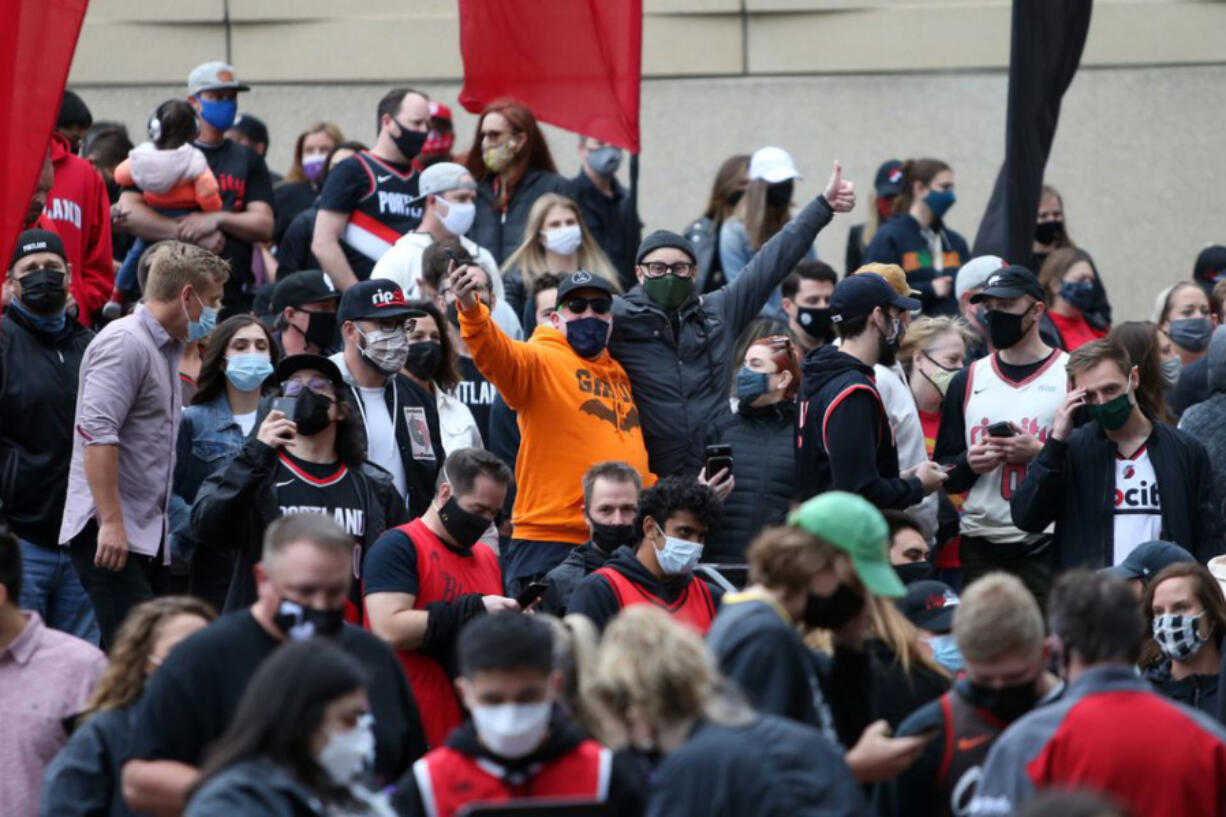 Blazers fans lineup outside the Moda Center before the Portland Trail Blazers take on the Denver Nuggets in Game 3 of their first-round NBA playoffs matchup on Thursday, May 27, 2021.