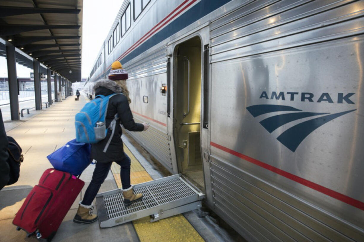 Passengers board the eastbound Empire Builder train to Chicago.
