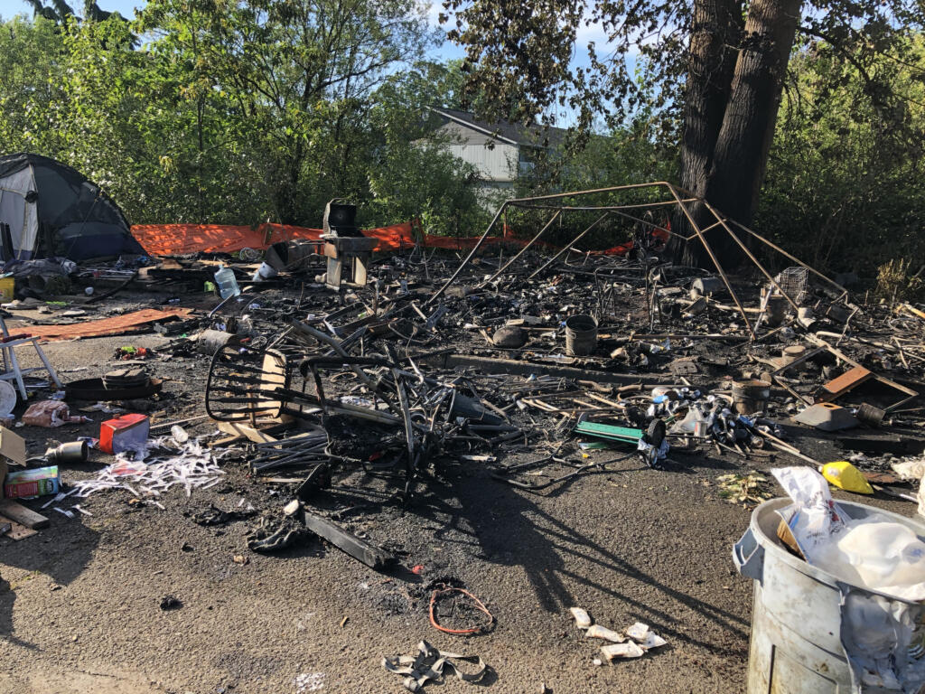 A fire destroyed a tent and other possessions at a homeless camp in east Vancouver early Monday morning.