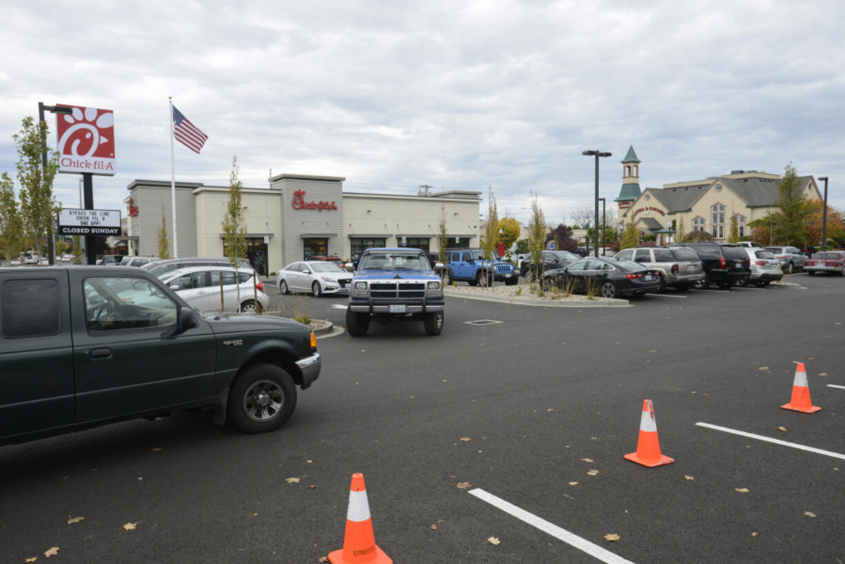 Customers try to find parking in the crowded Chick-fil-A parking lot on Southeast Mill Plain Boulevard in November 2016. The company recently submitted a preliminary application to expand its drive-thru capacity.