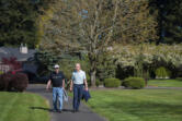 Richard Moody, 75, left, and his husband, Carl Caspersen, walk near their home in southeast Vancouver. Moody, who has lived 26 years with a transplanted heart, is careful to lead a healthy lifestyle and walks daily.