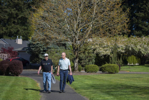 Richard Moody, 75, left, and his husband, Carl Caspersen, walk near their home in southeast Vancouver. Moody, who has lived 26 years with a transplanted heart, is careful to lead a healthy lifestyle and walks daily. (Photos by Amanda Cowan/The Columbian)