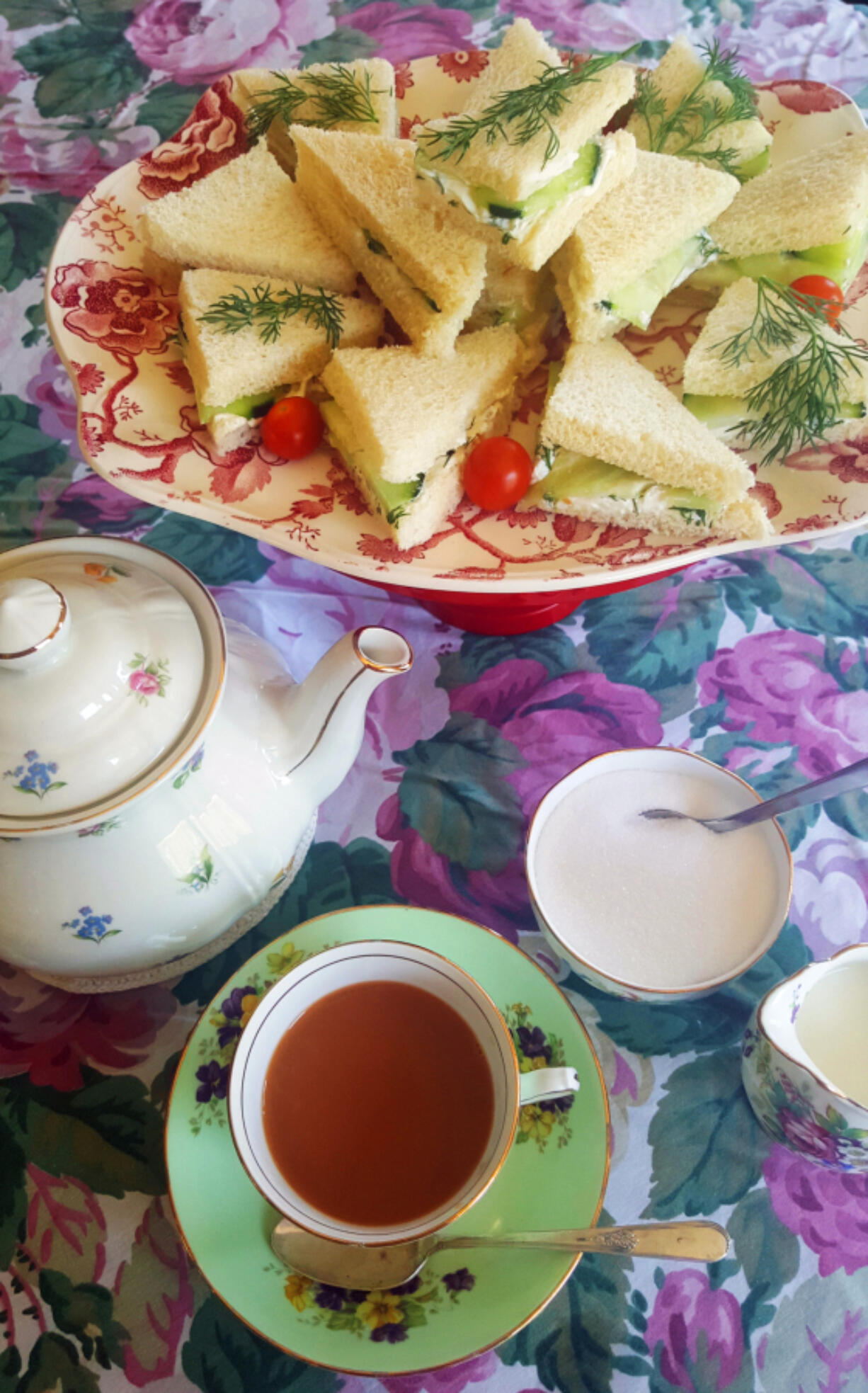 Put out an assortment of little sandwiches, tea, milk, sugar, scones and other treats and let guests serve themselves.
