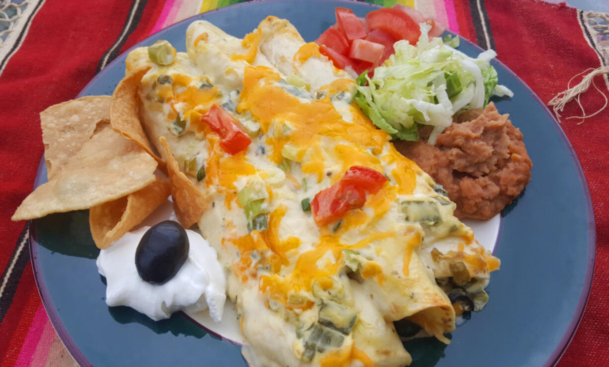 These creamy chicken enchiladas use chicken soup and sour cream for a cheesy, chicken-y enchilada, with savory flavor from green onions.