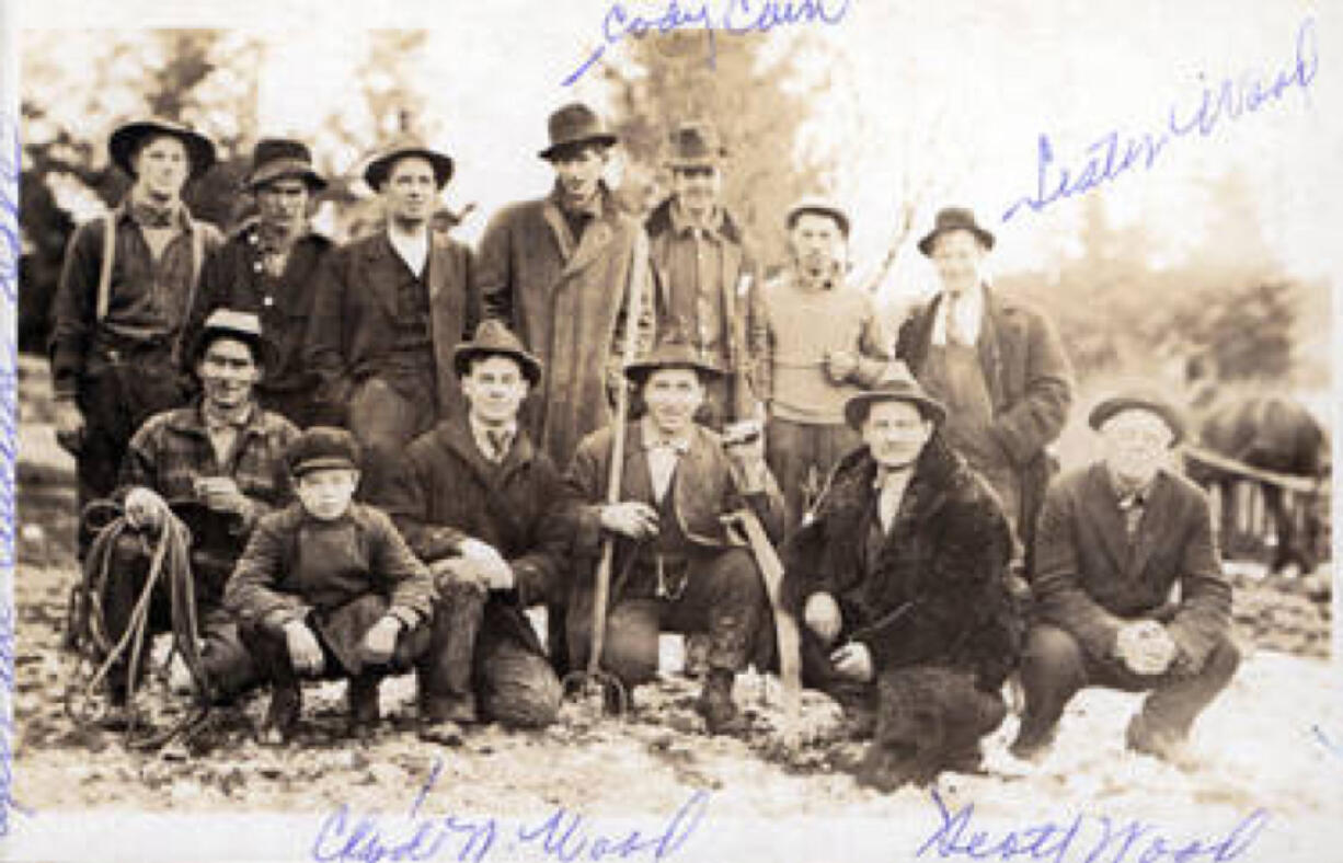 Before being elected the first Democratic sheriff in Clark County, Lester Wood (standing back row right) often worked in his father's business. Scott Wood ran a furniture business and auctioned farm equipment. After the conviction of his son's murderer, Scott Wood, distraught by the death penalty, hoped the governor might change it.