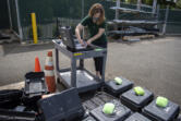Geophysicist Rebecca Kramer charges batteries for high-precision GPS equipment at USGS Cascades Volcano Observatory in Vancouver late last month. Staff was packing up monitoring gear being shipped to be used in studies of the volcanic system at Yellowstone National Park.