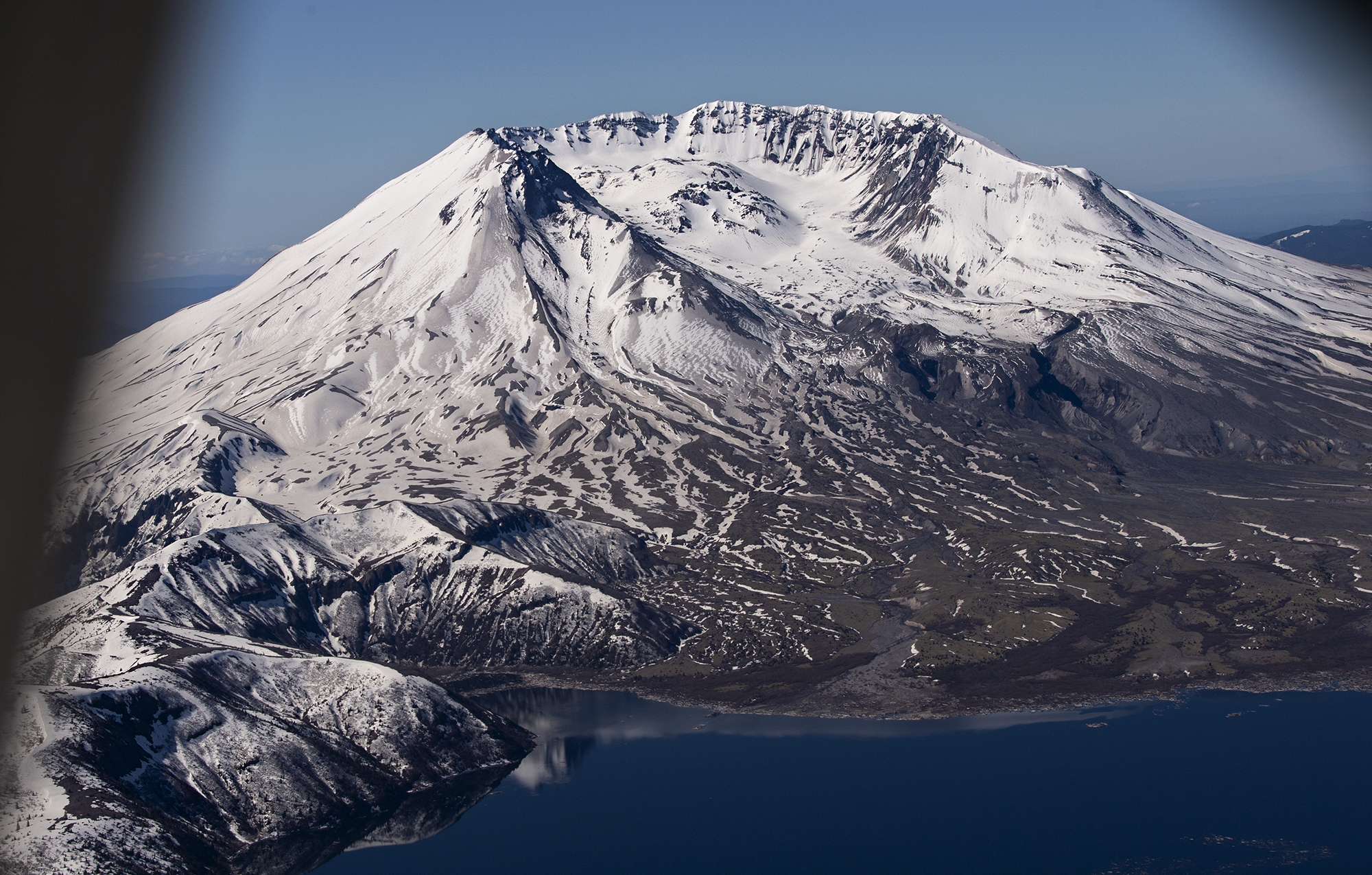 Clear skies light up Mount St. Helens, which is pictured from the air on Tuesday, May 11, 2021.