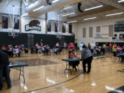 Volunteer and Clark County Public Health workers administer vaccines at Public Health's COVID-19 short-term vaccination pod at Woodland High School on May 8. Public Health administered 144 doses of Pfizer's vaccine at the event, and 183 doses of Johnson & Johnson's one-shot vaccine.