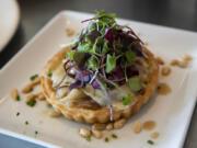A Walla Walla sweet onion tart dish at Roots Restaurant and Bar in Camas.